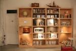 View of cabinet of curiosity with works by PG Future Migrations artists, as well as a show-within-a-show (in the center 2 vertical columns) curated by Curious Matter Gallery in Jersey city.